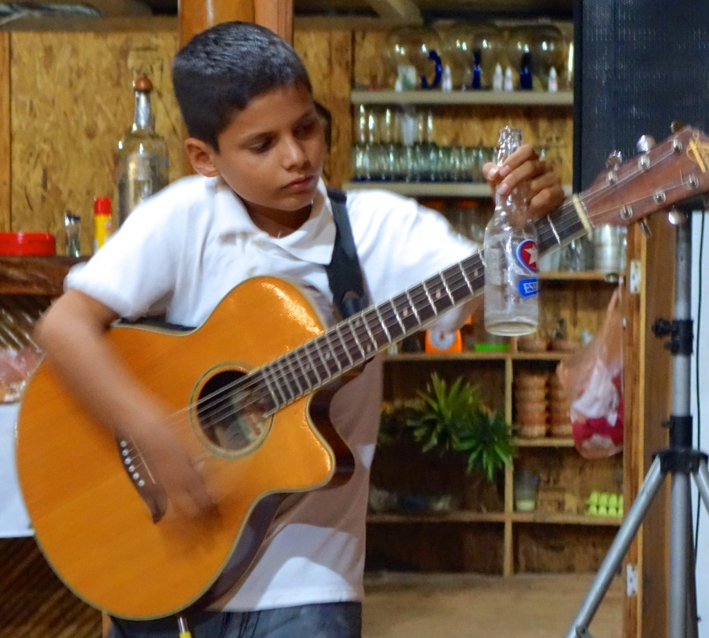 Budding Jimmy Hendrix who can also play his guitar when behind his head