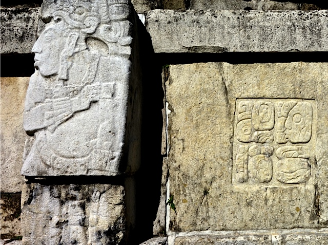A carving of another warrior in the Patio of the Captives, along with a Mayan hieroglyphic