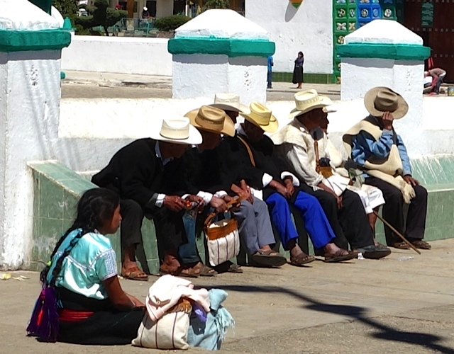 Men gathered in the plaza in front of the church in Chamula.
