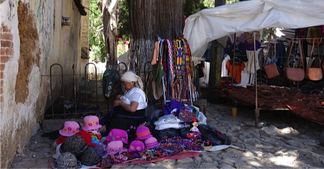 Woman selling handicrafts just outside the Mercado