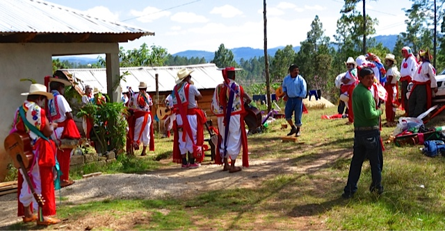 Shamans performing a ceremony at a roadside farm