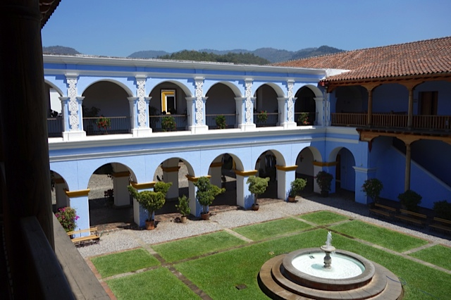 A courtyard of a large structure first a residence and later a seminary