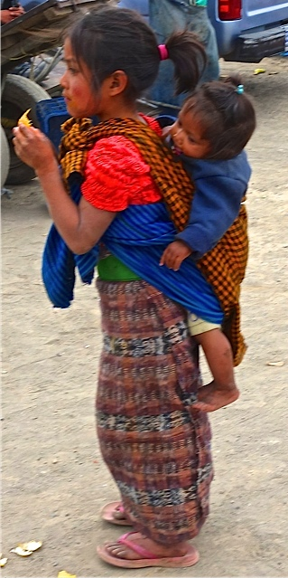 A young girl carrying her younger sibling--a common site in Guatemala