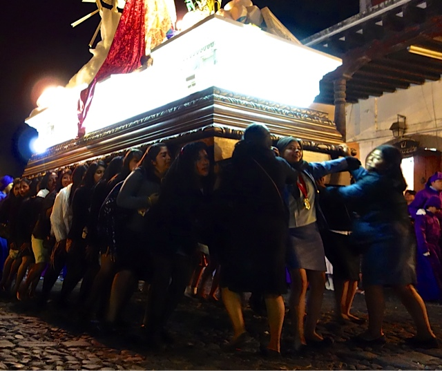 It takes 26 straining teenage girls to carry this float of the Virgin of Dolores