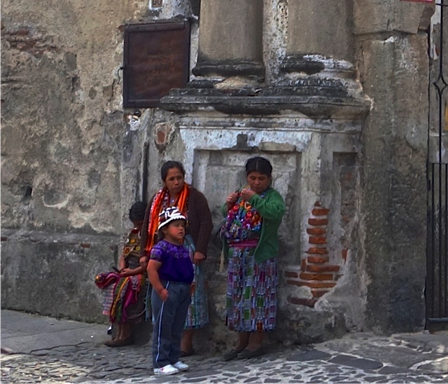 Mayans against the ruins of a local colonial church