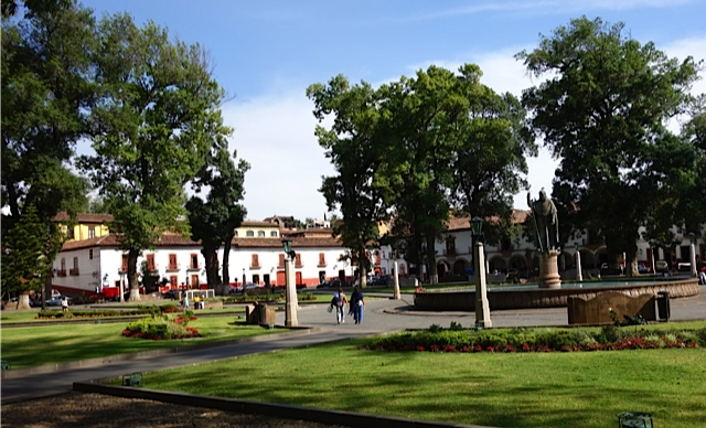 It's main plaza is spacious, green and treelined.