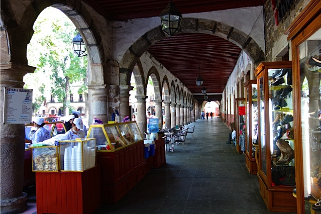Patzcuaro's main plaza is surrounded by arcades which provide both shade and shelter from the rain