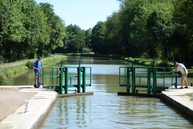 Barry and the lock master open the lock after it is filled