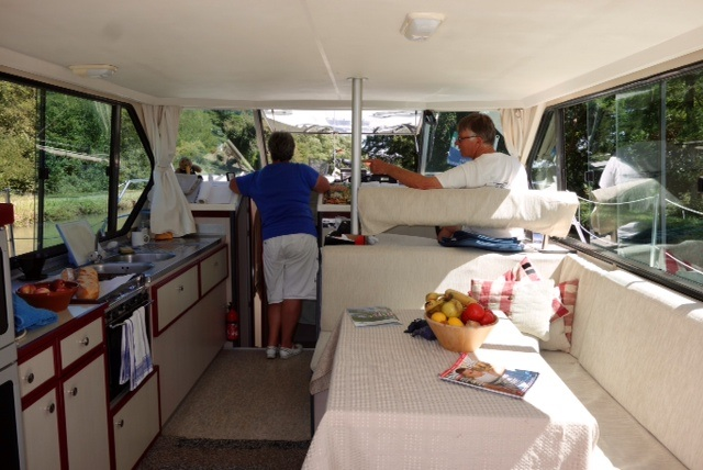 Malaga's interior with galley, driving station and table