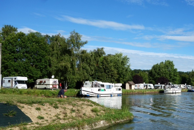 Boats and campers sharing the canal side