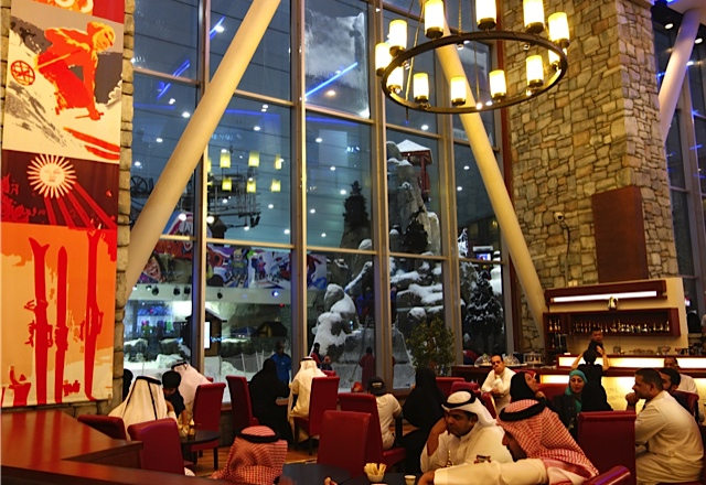 The apre ski restaurant with its giant fireplace and windows