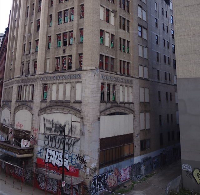 Graffiti covering the lower floors of an abandoned office building in the downtown area