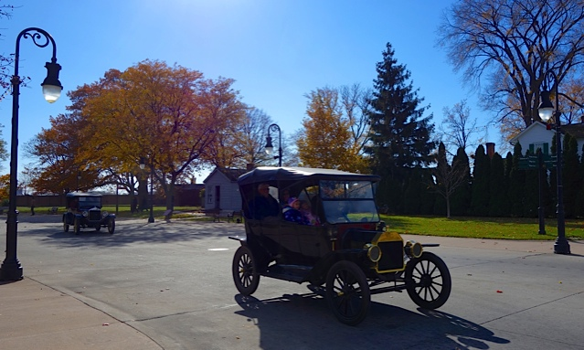 An original Ford Model T driving around Greenfield Village
