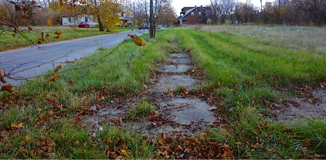 The sidewalks are disappearing into the fields