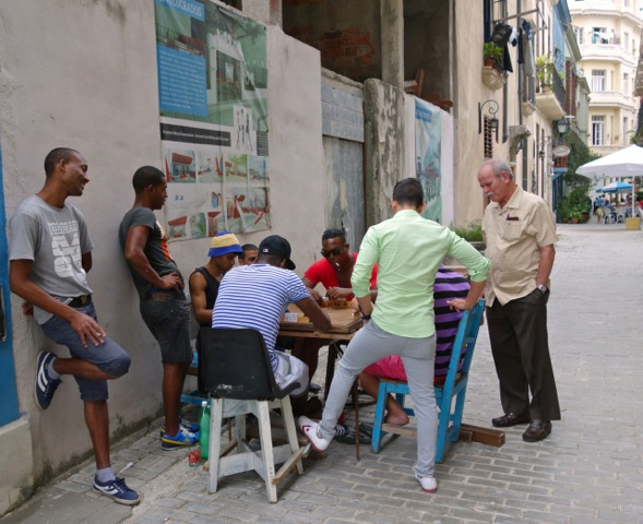 Just the guys in a side street in an intense game of dominoes