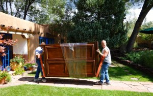 Jose and Javier carrying out an armoire