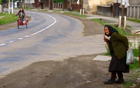 Crossing the street, watching for traffic. Maramures, Romania